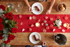 Overhead View Of Romantic Couple At Valentines Day Meal Stock Photos