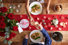 Overhead View Of Romantic Couple At Valentines Day Meal Royalty Free Stock Images