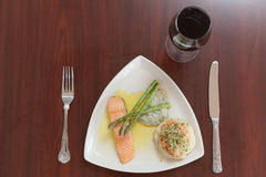 Overhead view of salmon dish with asparagus and red wine Stock Image
