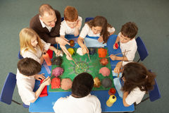 Overhead View Of Schoolchildren Working Together Stock Images