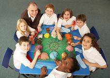 Overhead View Of Schoolchildren Working Together Stock Photo