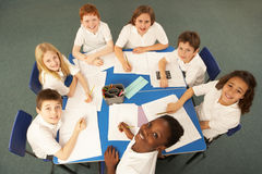 Overhead View Of Schoolchildren Working Together Royalty Free Stock Images