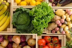 Separated wooden boxes of random produce royalty free stock photos