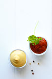 Serving of mustard and tomato ketchup Stock Images