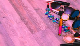 Overhead view of set female essential beauty items on pink flat lay. Decorative beauty makeup stuff stock photography