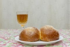 Overhead view of Shabbat eve table with uncovered challah bread and Kiddush wine cup. copy space. Challah and wine on the Sabbath. Table royalty free stock photography
