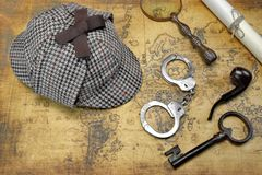 Overhead View Of Sherlock Hat And Detective Tools On Map Royalty Free Stock Images