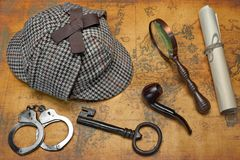 Overhead View Of Sherlock Hat And Detective Tools On Map Royalty Free Stock Photo