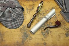 Overhead View Of Sherlock Hat And Detective Tools On Map Stock Photo
