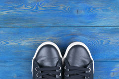 Overhead view of shoes on blue wooden floor. Shoes on a wooden background. Sneakers on a wooden floor. Sport, fitness, shoes, foot royalty free stock photography