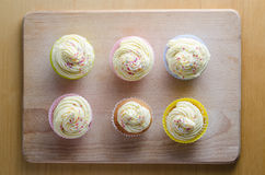 Overhead View of Six Decorated Cupcakes Stock Image