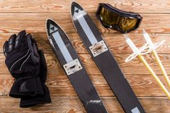 Overhead view of ski accessories placed on rustic old wooden table royalty free stock image