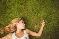 Overhead view of smiling woman looking away at park Stock Photography