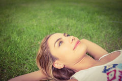 Overhead view of smiling woman looking up  at park Royalty Free Stock Image