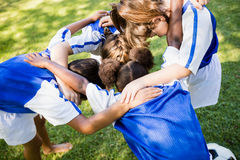 Overhead view of soccer team forming huddle Royalty Free Stock Images