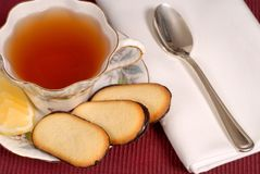 Overhead view of a soothing cup of tea in china cup. With lemon and cookies royalty free stock image