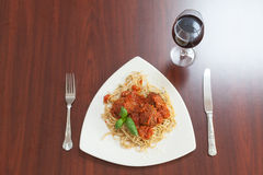 Overhead view of spaghetti and meatballs with basil leaf Stock Photo