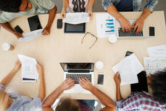 Overhead View Of Staff With Digital Devices In Meeting Stock Image