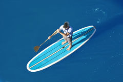 Overhead view of stand up paddleboarder Royalty Free Stock Photo