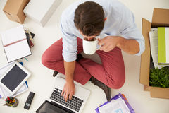 Overhead View Of Start Up Business Moving Into Office stock images