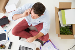 Overhead View Of Start Up Business Moving Into Office Stock Photo