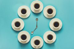 Overhead view of the steps in drinking a cup of fresh espresso. Coffee clock. Art food. Good morning concept. Toned stock photo