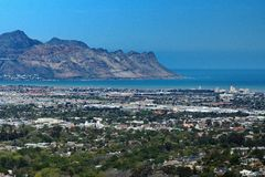 Overhead view of Strand, South Africa. Overhead view of Table Bay and the suburb of Strand, near Cape Town, South Africa, with mountains in the background stock photos