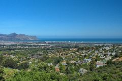 Overhead view of Strand, South Africa. Overhead view of Table Bay and the suburb of Strand, near Cape Town, South Africa, with mountains in the background stock image