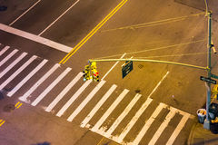 Overhead view of street intersection at night in NYC. Overhead view of street intersection at night with crosswalk and traffic lights in New York City Stock Photography