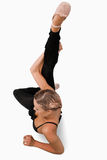 Overhead view of stretching dancer. Against a white background Royalty Free Stock Images