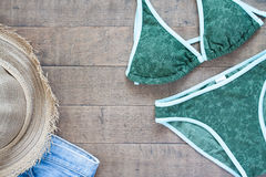 Overhead view of Summer collection with bikini on wood Stock Image