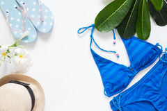 Overhead view of summer concept with blue stripe bikini Stock Photo