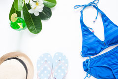 Overhead view of summer concept with blue stripe bikini Stock Images
