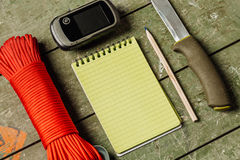 Overhead view of survival gear equipment to survive and Noteboo stock photos