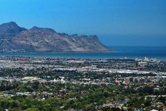 Overhead view of Strand, South Africa. Overhead view of Table Bay and the suburb of Strand, near Cape Town, South Africa, with mountains in the background royalty free stock photo