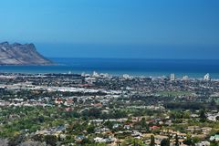 Overhead view of Strand, South Africa. Overhead view of Table Bay and the suburb of Strand, near Cape Town, South Africa, with mountains in the background stock photo