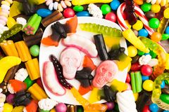 Overhead view of table with candies for halloween royalty free stock images