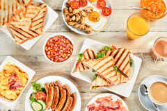 Overhead view of a table with english breakfast. Assortment of the english tradition of morning food royalty free stock photos