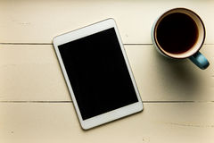 Overhead view of tablet and cofee on wood Royalty Free Stock Photos