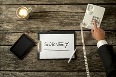 Overhead view of telephone operator making survey on the phone stock photo