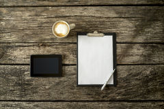 Overhead view of textured rustic wooden study or office desk Royalty Free Stock Image