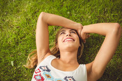 Overhead view of thoughtful woman with arms raised Stock Photography