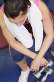 Overhead view of a tired and thoughtful woman in gym Royalty Free Stock Photos