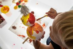 Overhead view of toddler boy making holiday decoration stock photo