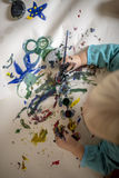 Overhead view of toddler child painting with water colours Stock Photos
