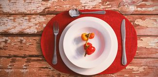 Overhead view of tomatoes served in plate. On wooden table Stock Photography