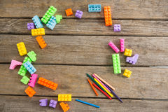 Overhead view of toy blocks with crayons. On wooden table Stock Images