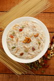 Overhead view- traditional Indian sweet pudding Kheer in a white bowl Royalty Free Stock Image