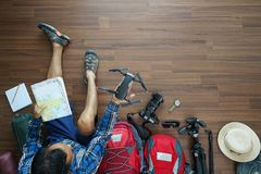 Overhead view of traveler man plan and backpack planning vacatio Royalty Free Stock Photography