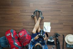 Overhead view of traveler man plan and backpack planning vacation travel Royalty Free Stock Image